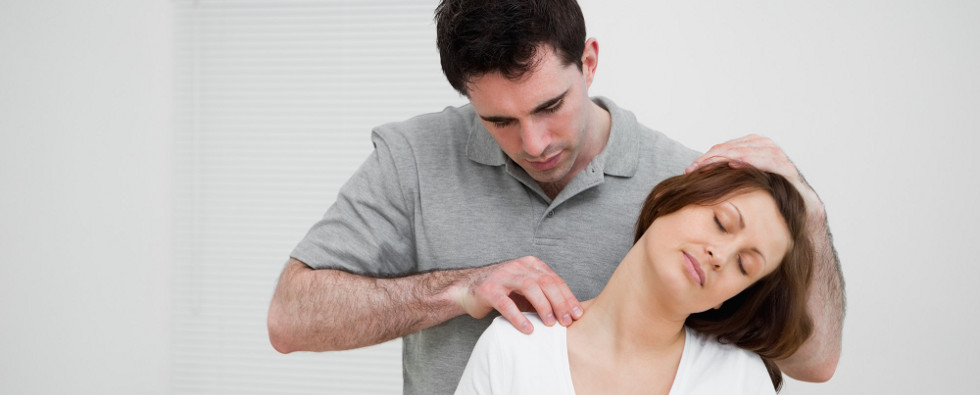 A therapist manipulating a patient's shoulder